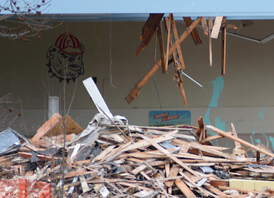 The old style bulldog mascot of Faubion School guards the demolition site. Photo by Carl Jameson