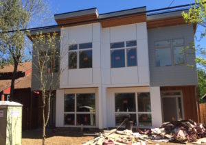 This new duplex under construction is the one discussed in this article; the author lives directly north of the new building. The project is located on NE 32nd Avenue between Emerson and Sumner streets. Photo by Susan Trabucco