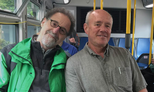 Geoffrey Hiller (left) and Tom Vandel rode TriMet Line 75 for months to cover – in photos and words – the pulse of society along its route from Milwaukie to St. Johns via 42nd Avenue. The project is on exhibit at Concordia University.